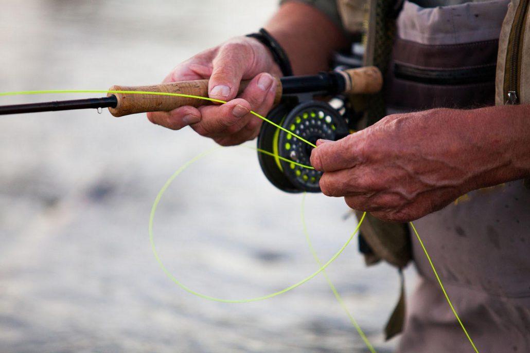 Elderly man fly fishing