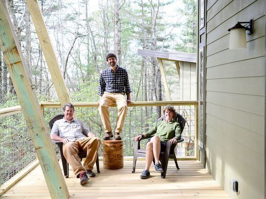 lane collin beth sitting on deck of cabin